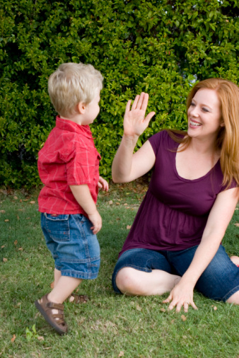 mom high fiving son