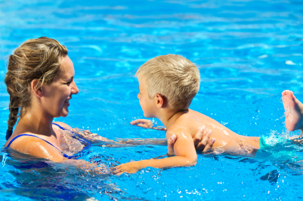 Mother with child at the pool