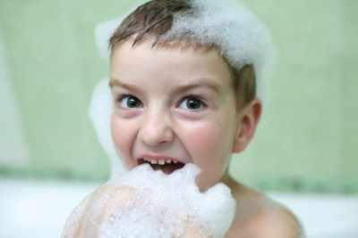 Little boy resistant to taking a bath