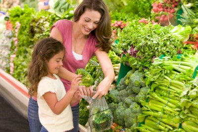 Mother shops for food with child at the supermarket