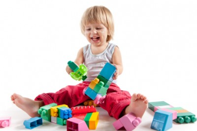 Infant girl playing with toys
