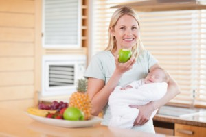 Mother eating with infant