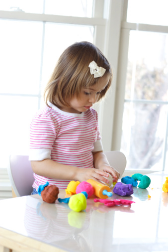 Little girl playing Play-doh