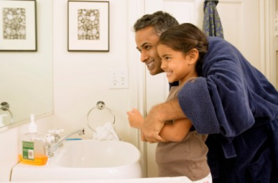 Father practicing oral awareness with child