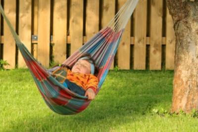 Little girl sleeping in hammock
