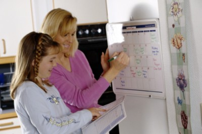 Mother and daughter planning a schedule