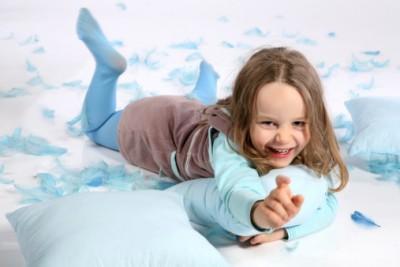girl on a floor pillow