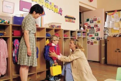 mom and teacher with boy
