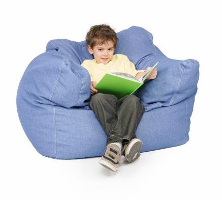 boy reading on giant pillow