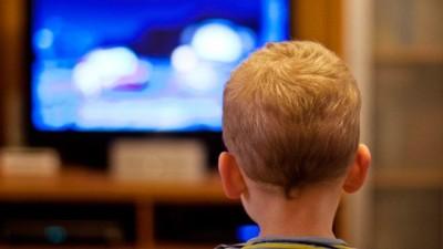 boy watching the news