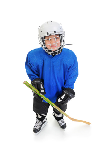 Little boy playing hockey