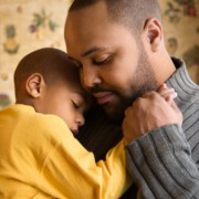 Father Consoling Child