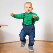 boy learning to walk