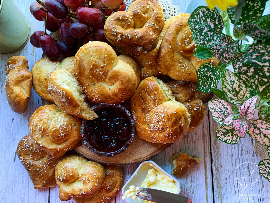 Heart-shaped Armenian Choreg Easter Bread on table with butter and jam