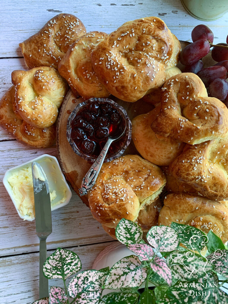 Heart-shaped Armenian Choreg on a table with Ijevan jam and grapes