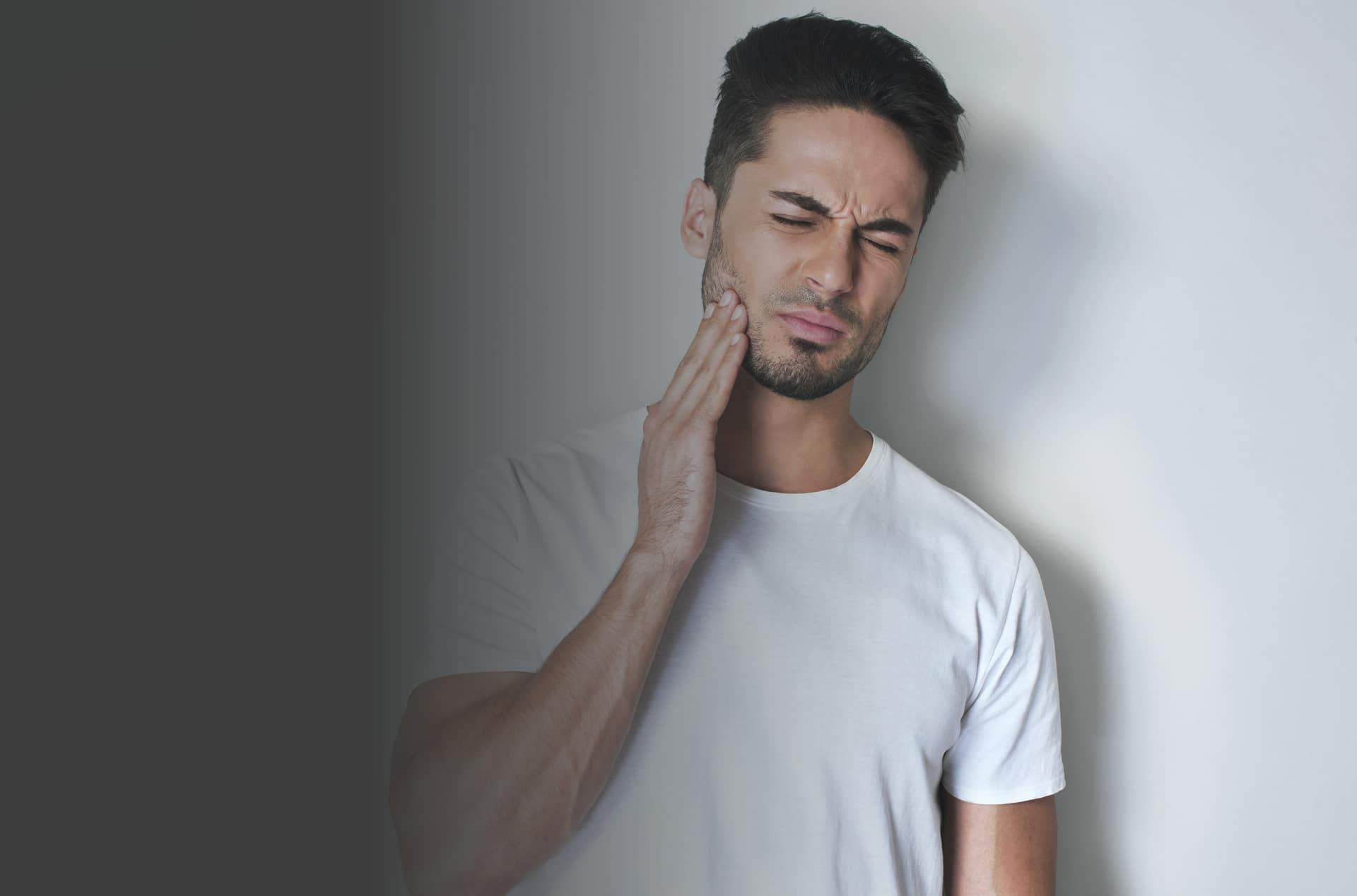 Man suffering with TMJ problems