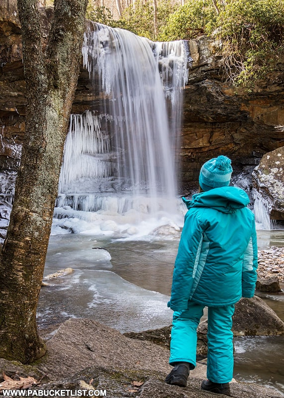 A young explorer checking out Cucumber Falls.