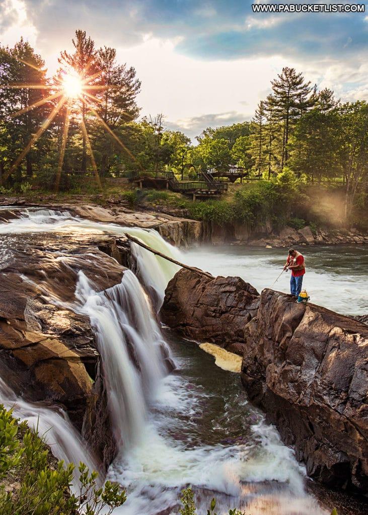 A fisherman at Ohiopyle Falls on a summer morning.