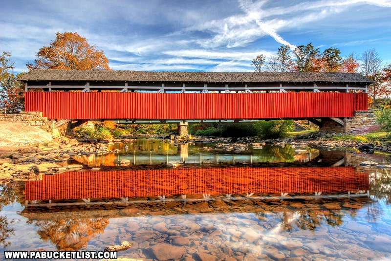 An autumn reflection of Kings Covered Bridge.