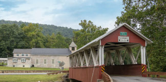 Saint Mary's Covered Bridge with Saint Mary's Catholic Church in the background.