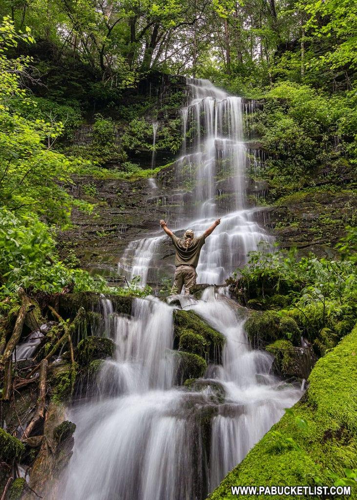 Hiker at Burdic Run Falls in Tioga County Pennsylvania