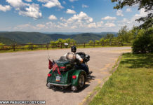 A biker enjoying the scenic view from High Knob Overlook.