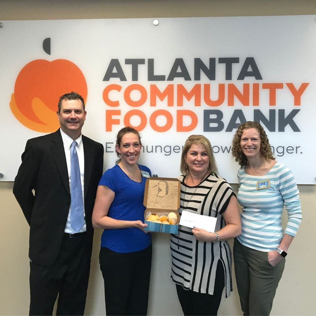 Birthday Cake Macaron Campaign Check Presentation to Atlanta Community Food Bank