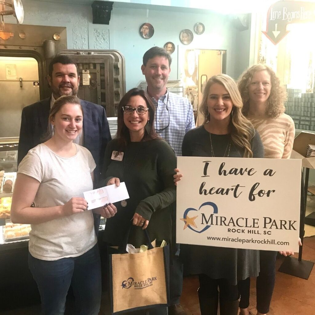 Birthday Cake Macaron Campaign Check Presentation to Miracle Park Rock Hill