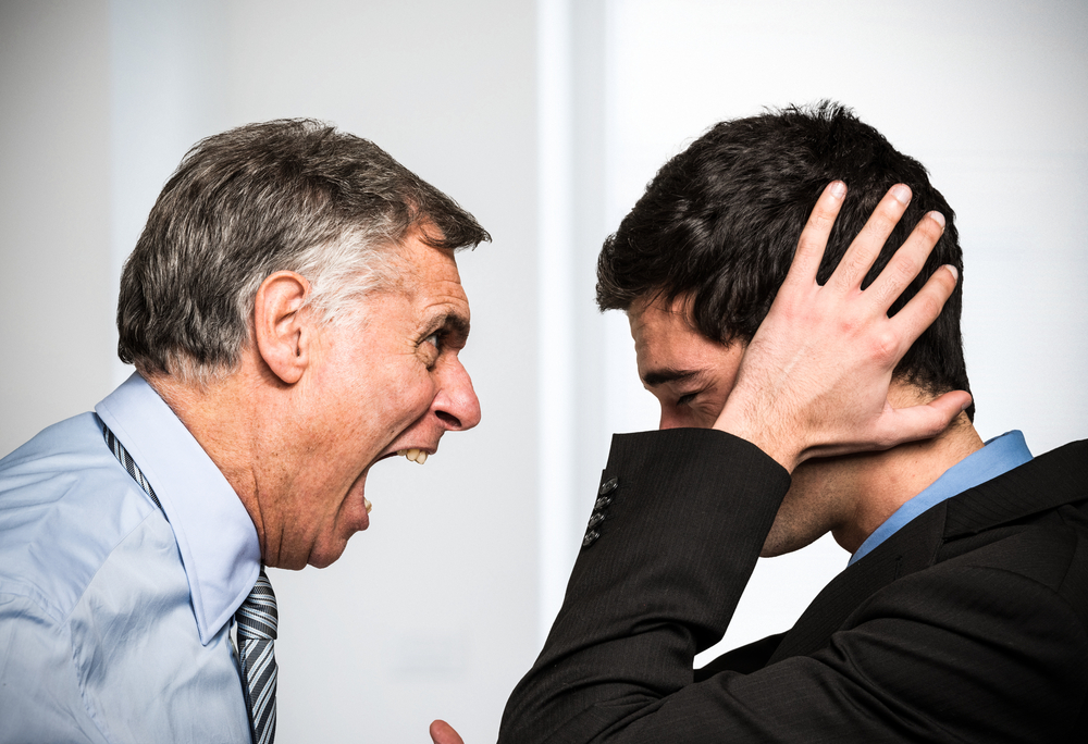 Image of boss shouting at employee