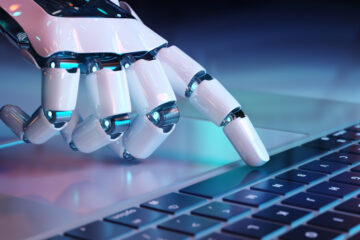 Image of robotic hand typing on keyboard