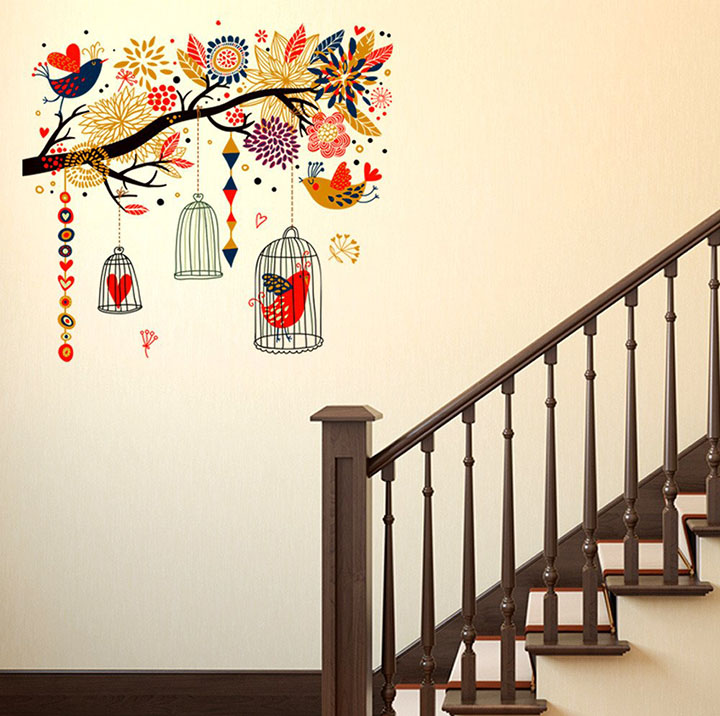 branch with elements of bird and cage wall sticker