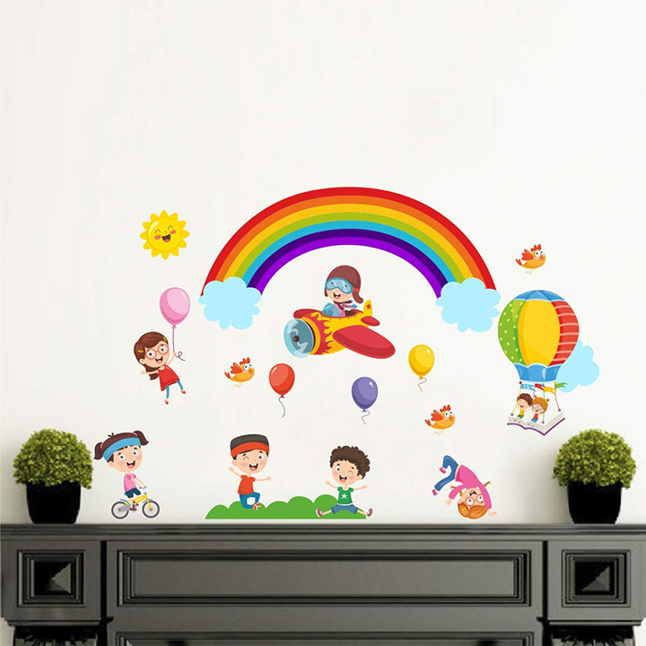 kids play with rainbow balloon in open sky wall sticker