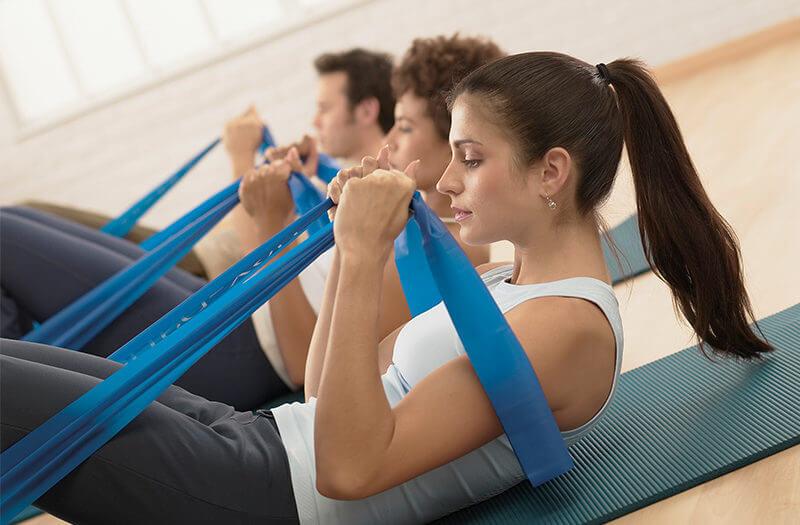 STOTT PILATES® Group Mat Workout with pilates bands resistance training