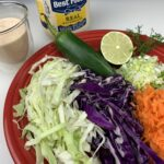 coleslaw ingredients on red plate