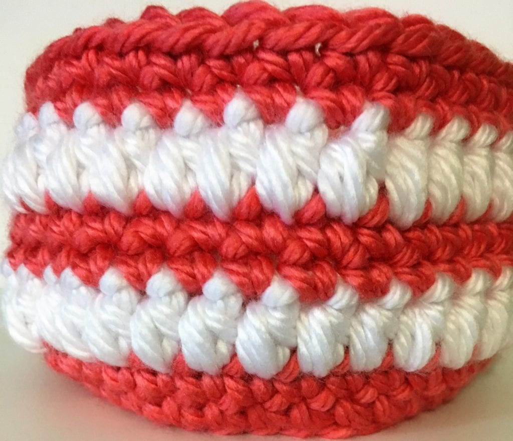 close up of coral and white basket