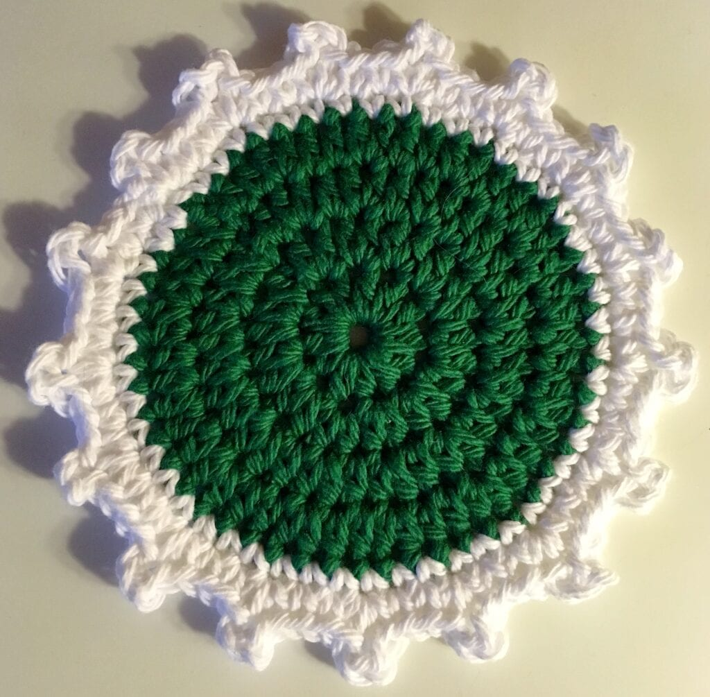 Close up of Green and White Coaster