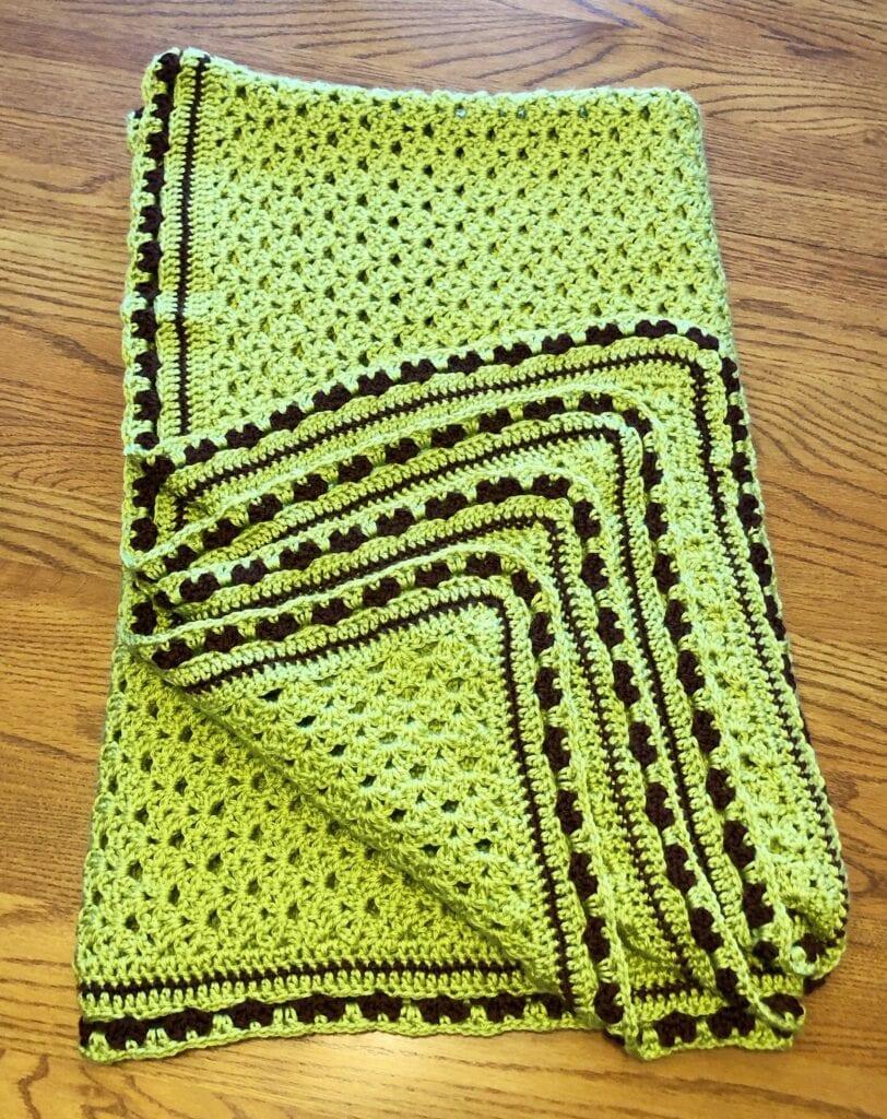 Folded Glorious Springtime Blanket Folded showing Crochet Edge
