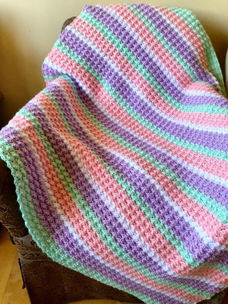pastel blanket on chair
