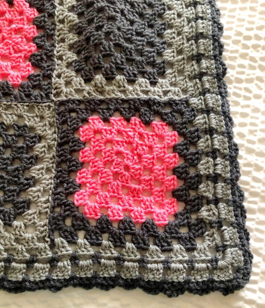Close-up showing the detail of the simple loop granny square crochet blanket