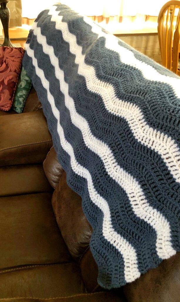 Crochet Blanket Draped Over Back of Sofa