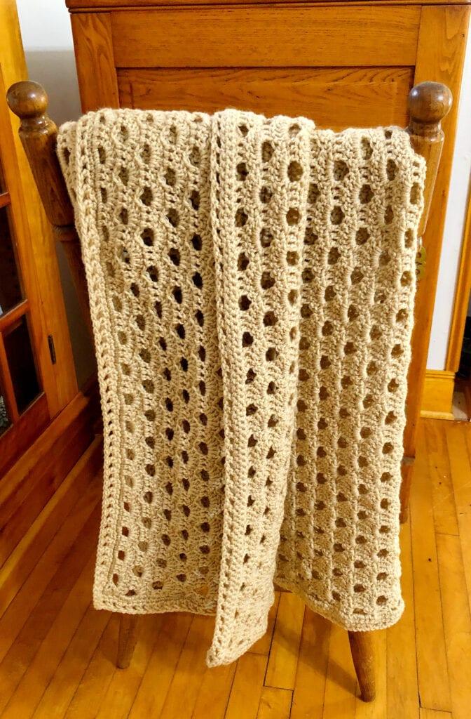 Crochet Shell Blanket Folded Over Chair