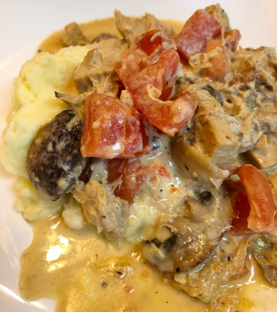 Creamy Chicken Served over Mashed Potatoes