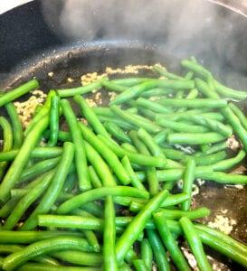 Adding Beans to Garlic in Skillet