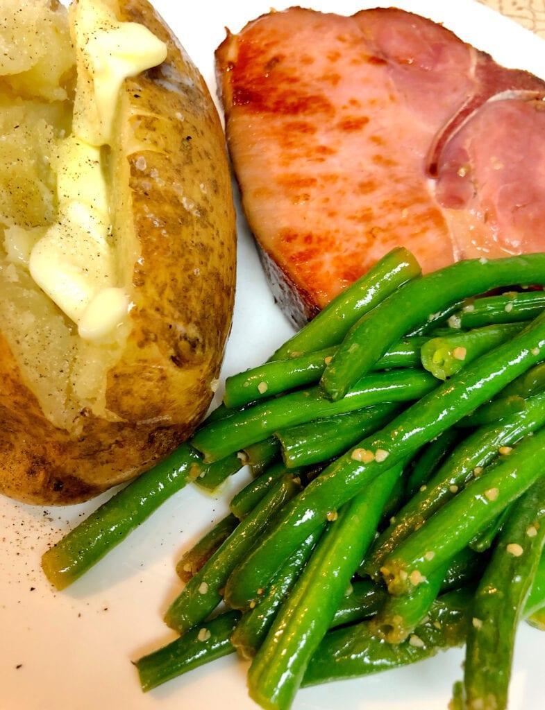 Skillet Garlic Green Beans, Smoked Pork Chops, and Baked Potato