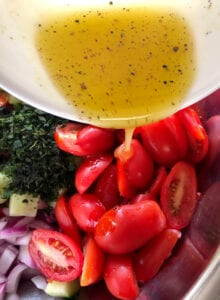 Adding Salad Dressing to the Tomato and Cucumber Mixture