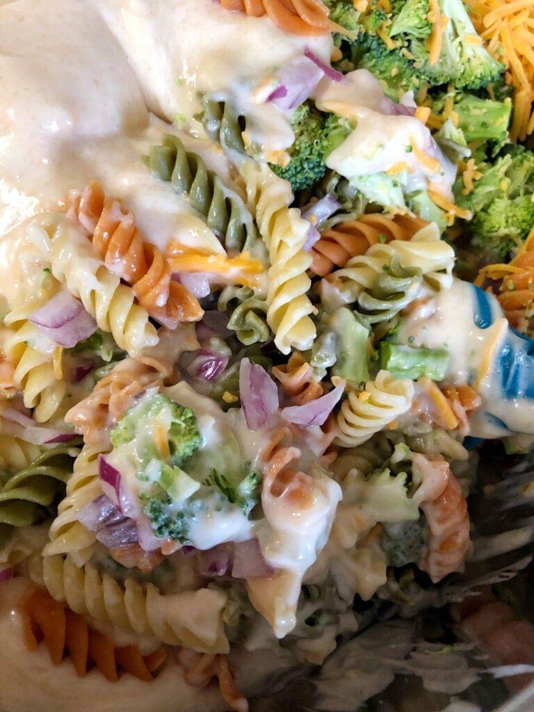 Adding Salad Dressing to the Broccoli Pasta Salad