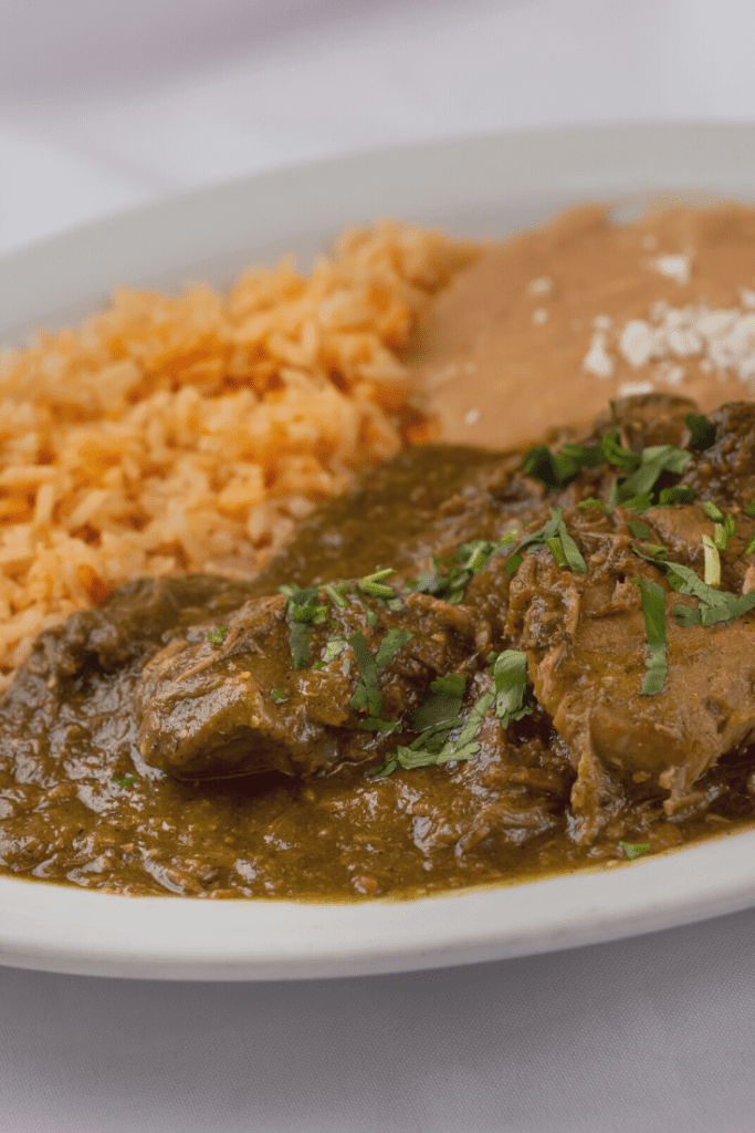 Pork Chile Verde Served with Rice and Homemade Beans