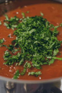 Adding Fresh Basil to the Spaghetti Sauce