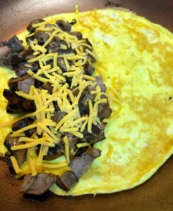 Adding the Steak Filling to the Omelette