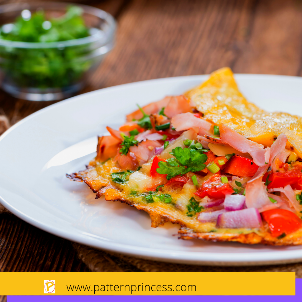 Omelette with fresh ingredients like tomatoes, onions, and basil